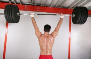 Lifting a heavy barbell over your head is sure to grow your shoulders.